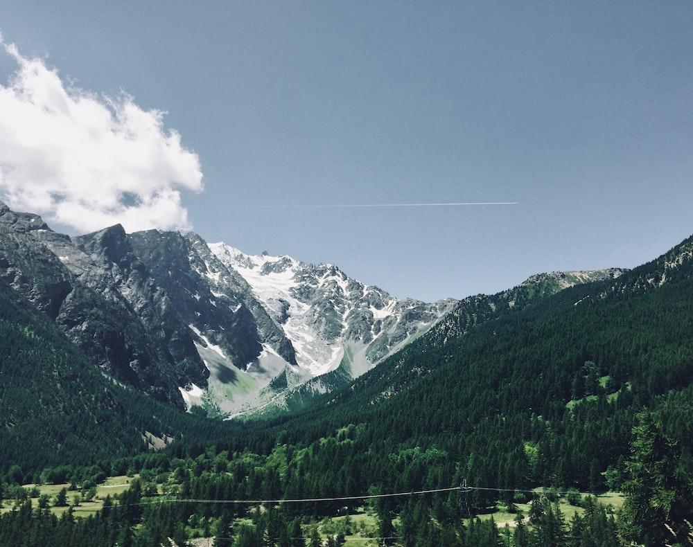 mountain under white skies view
