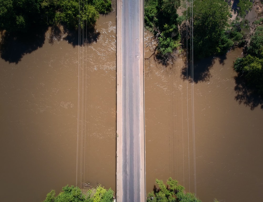 aerial photography of road above body of water during daytime
