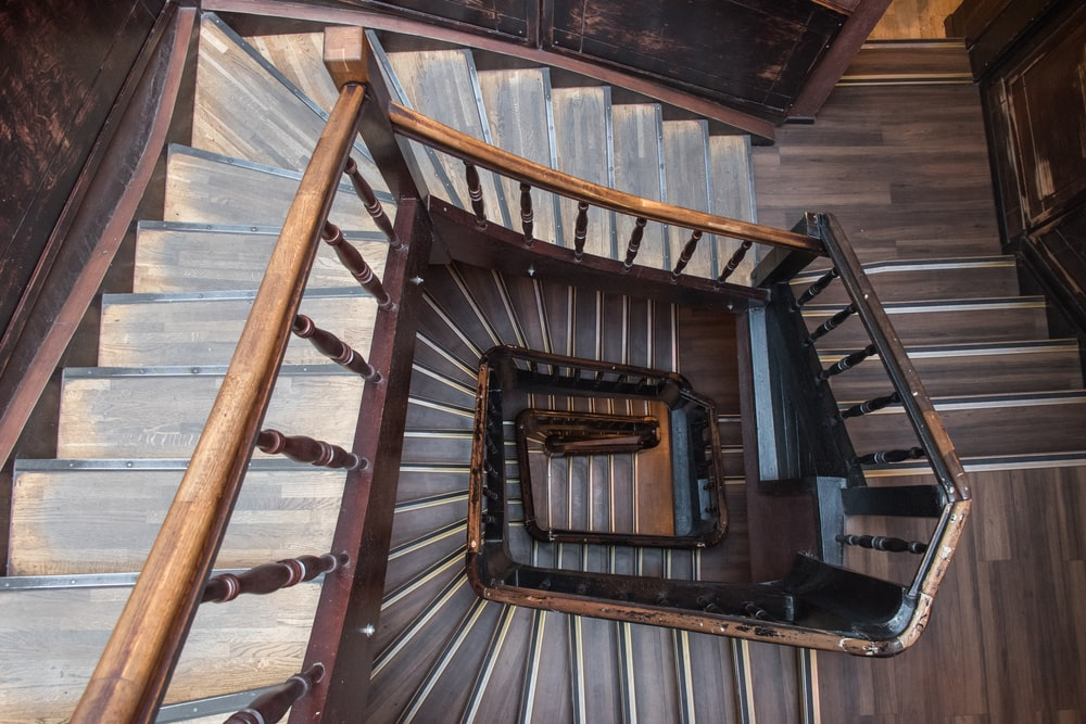 upper view of brown wooden spiral stairs