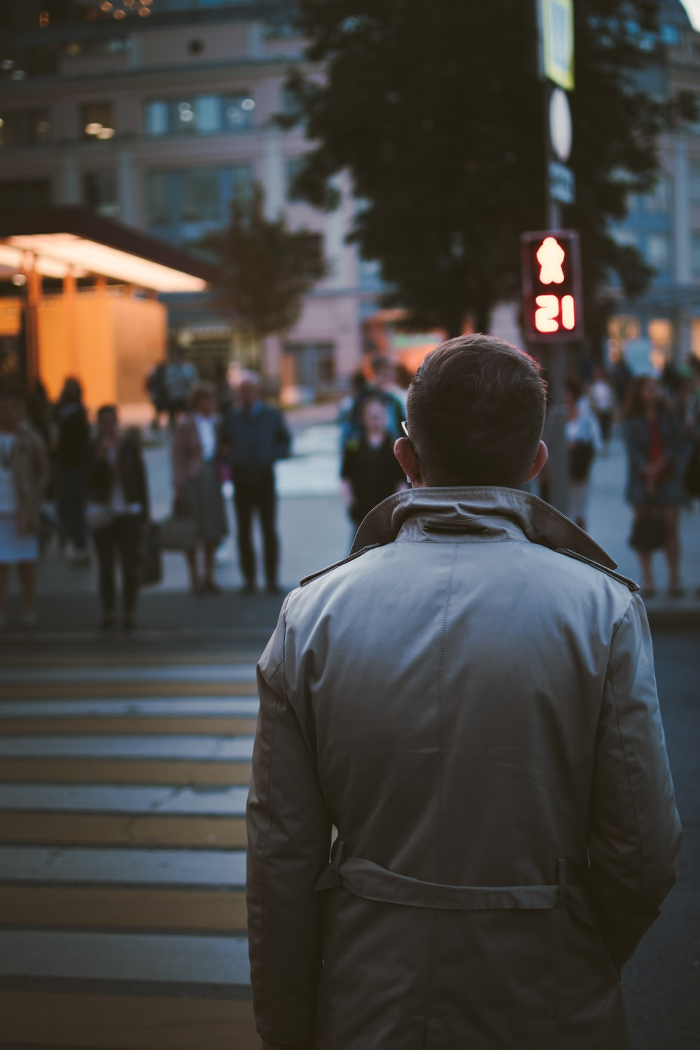 selective-focus photography of man walking on street