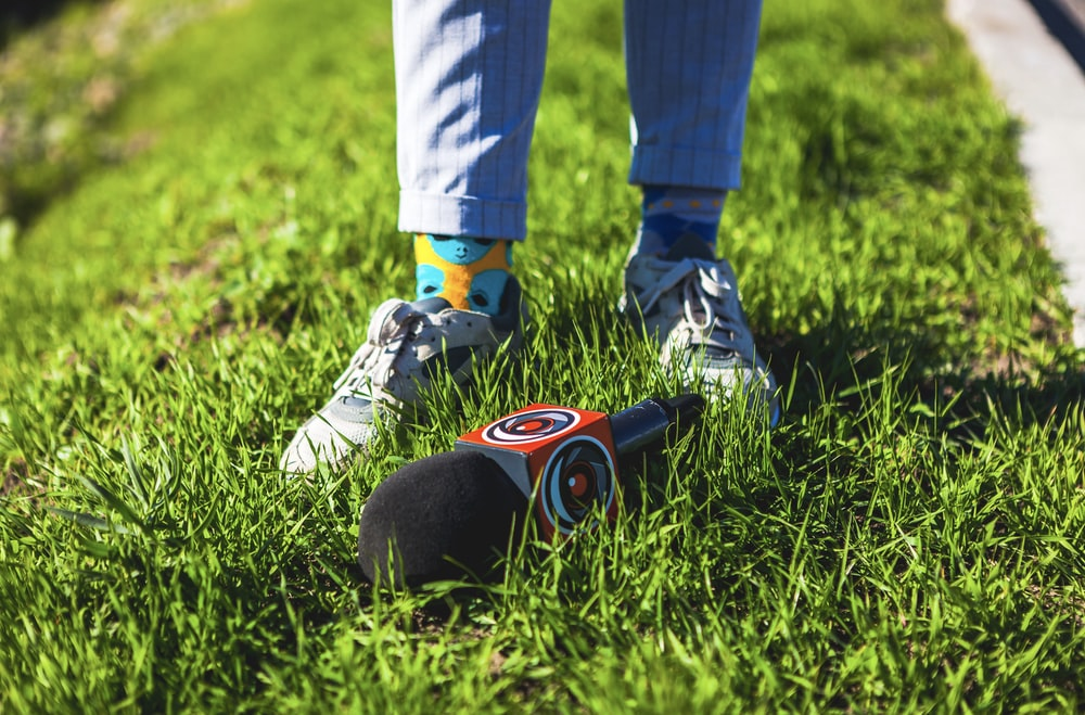 microphone on grass beside person's feet