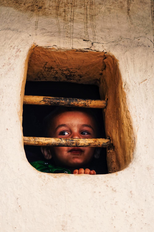 girl standing near window during daytime