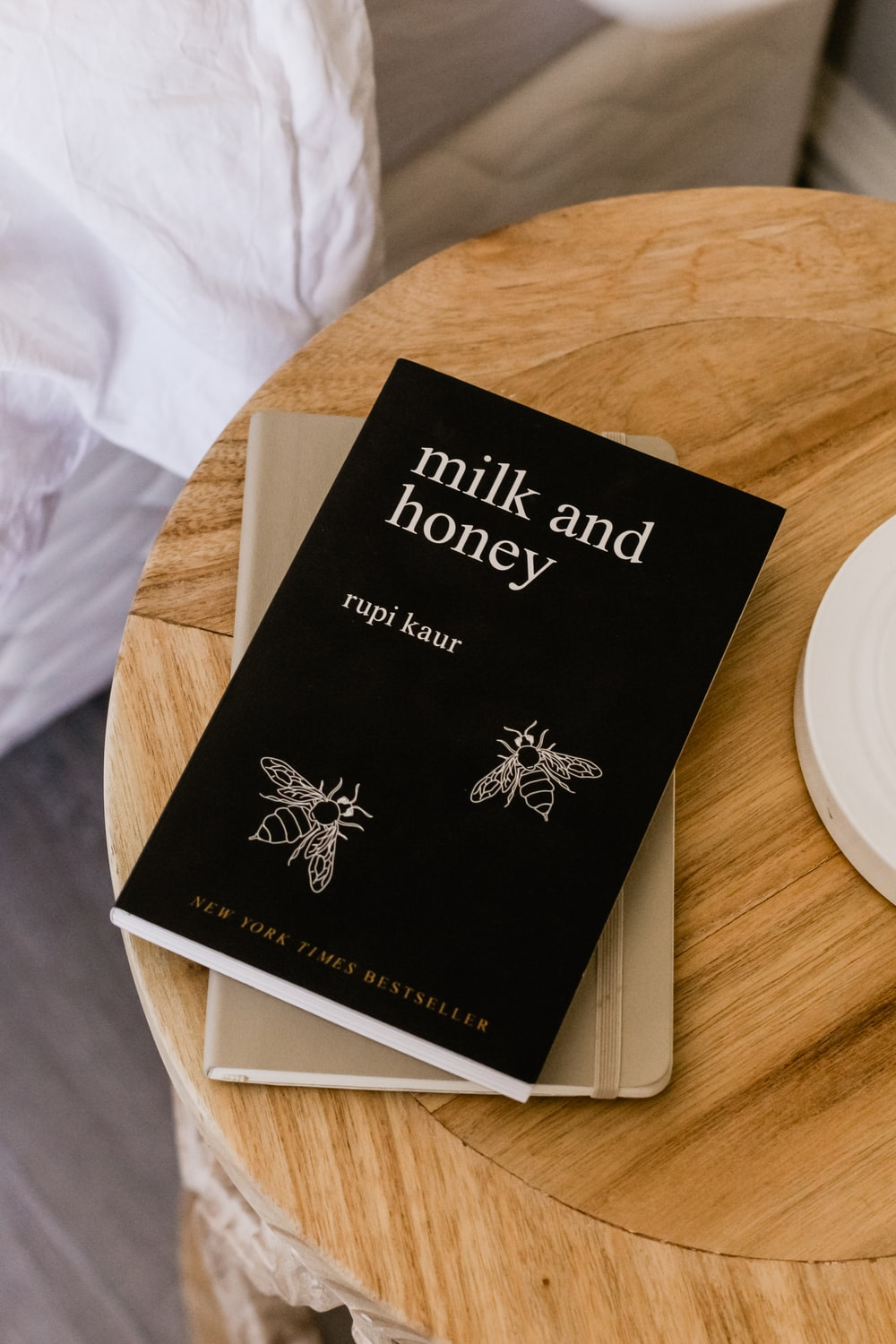 Milk and Honey by Rupi Kaur book on side table