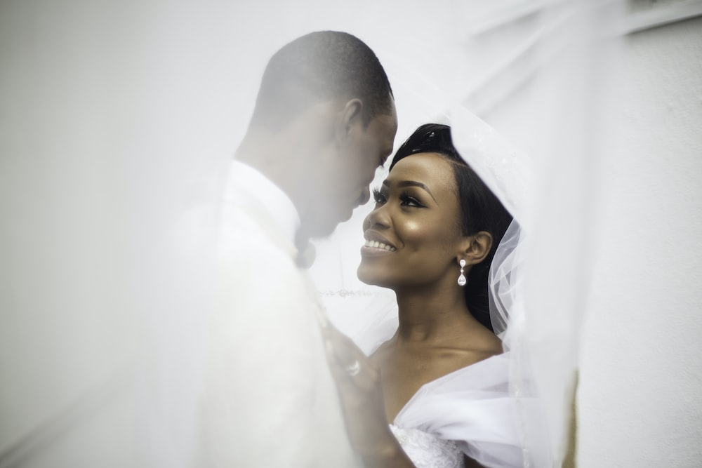selective focus photography of happy newly wed couple