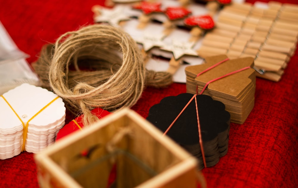 assorted art crafts on red textile