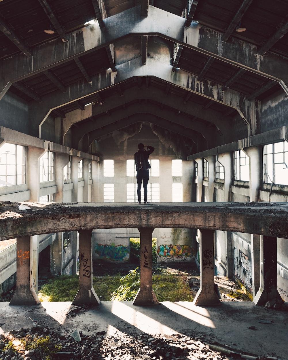 man standing on abandon house