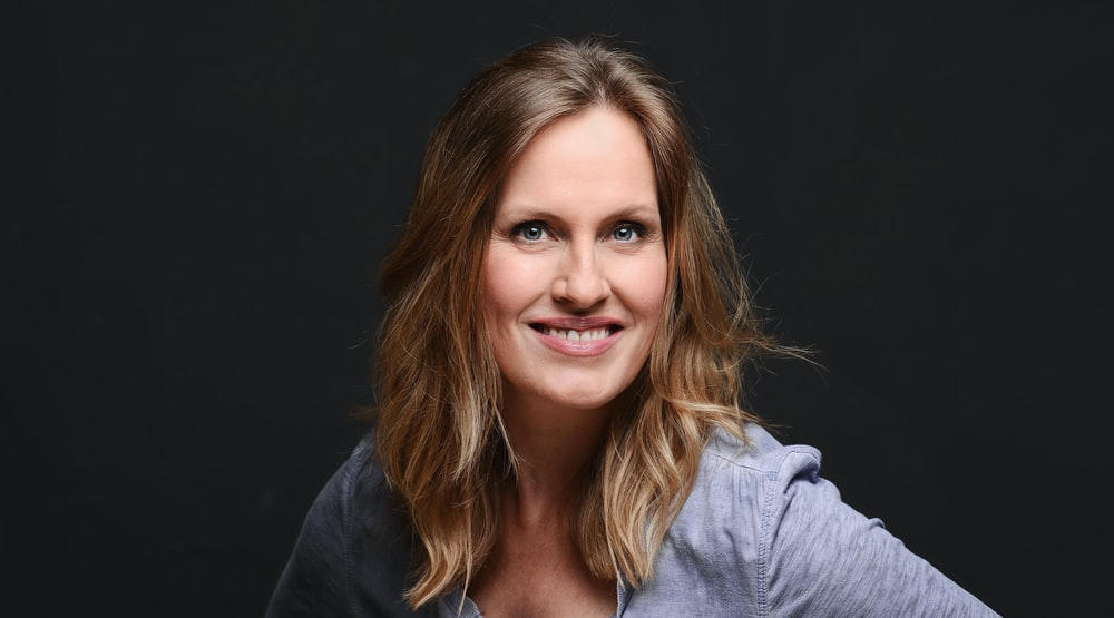 woman smiling with black background