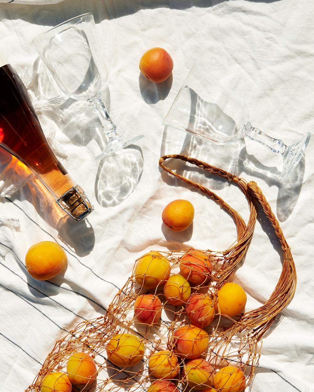 orange fruit on white textiles