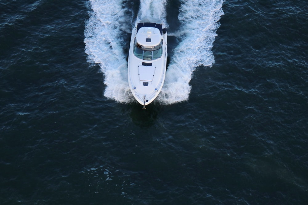 white speedboat in the middle of body of water