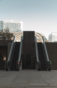 two escalators during day