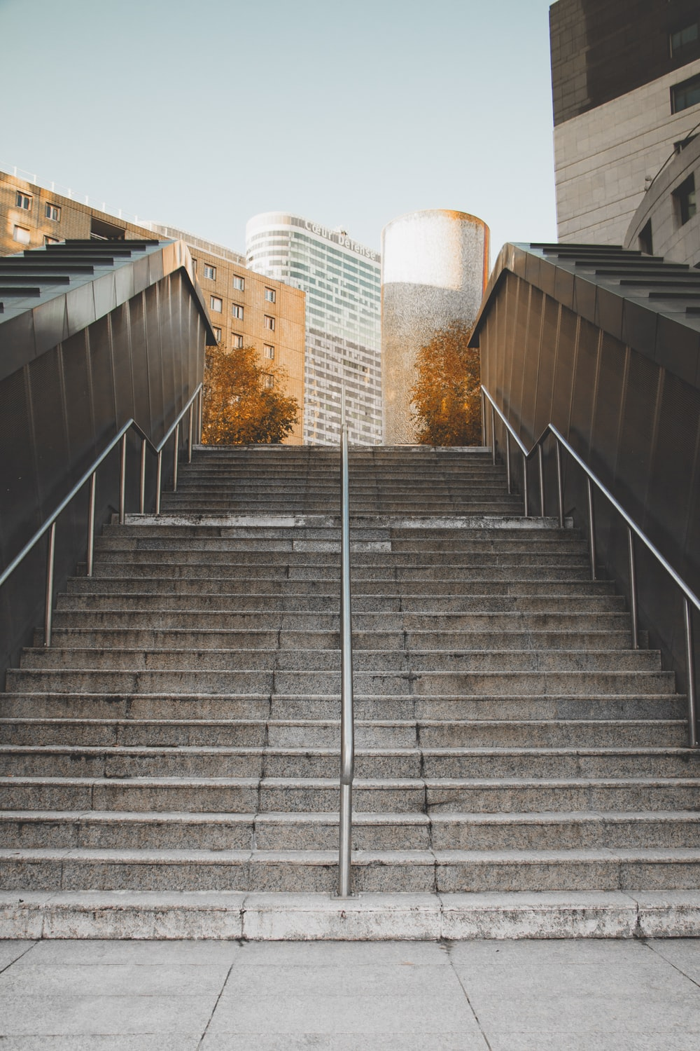 gray concrete stair outdoor during daytime