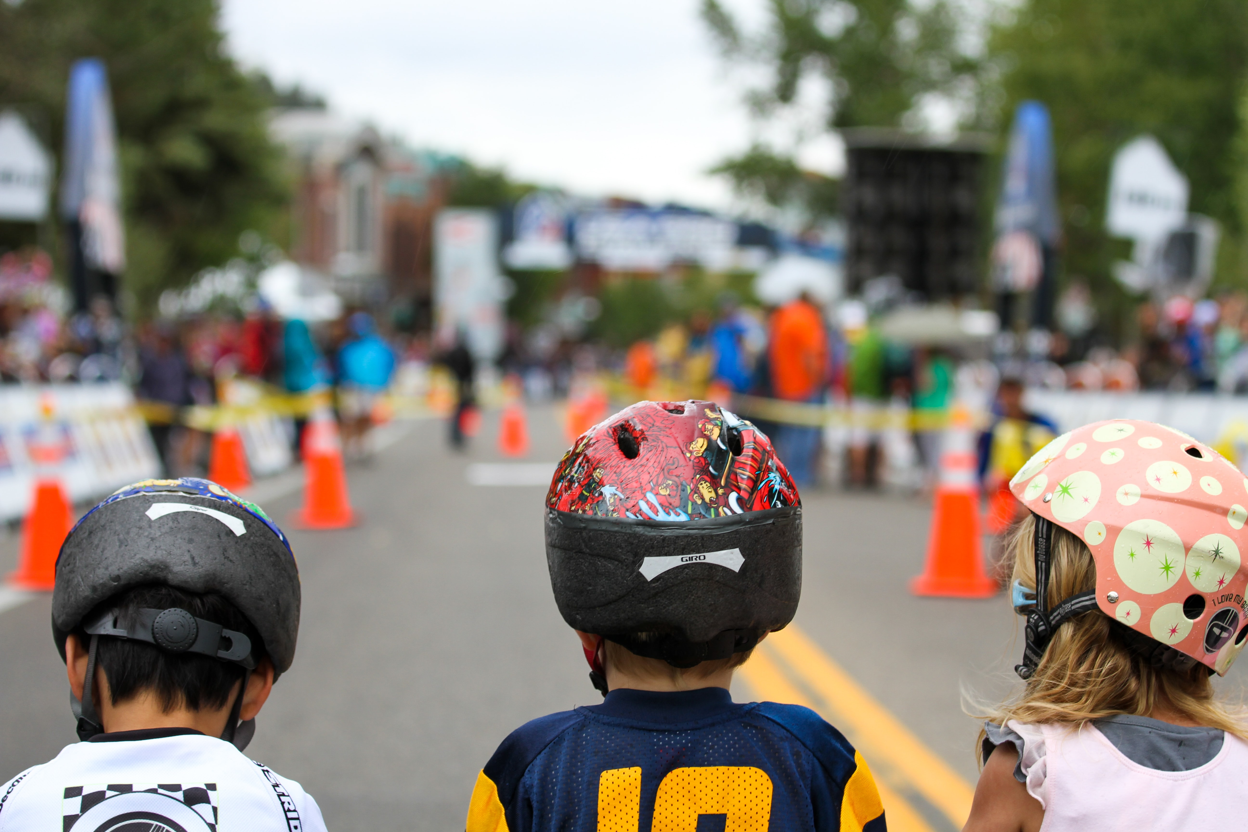 girl and boy wearing multicolored helmets