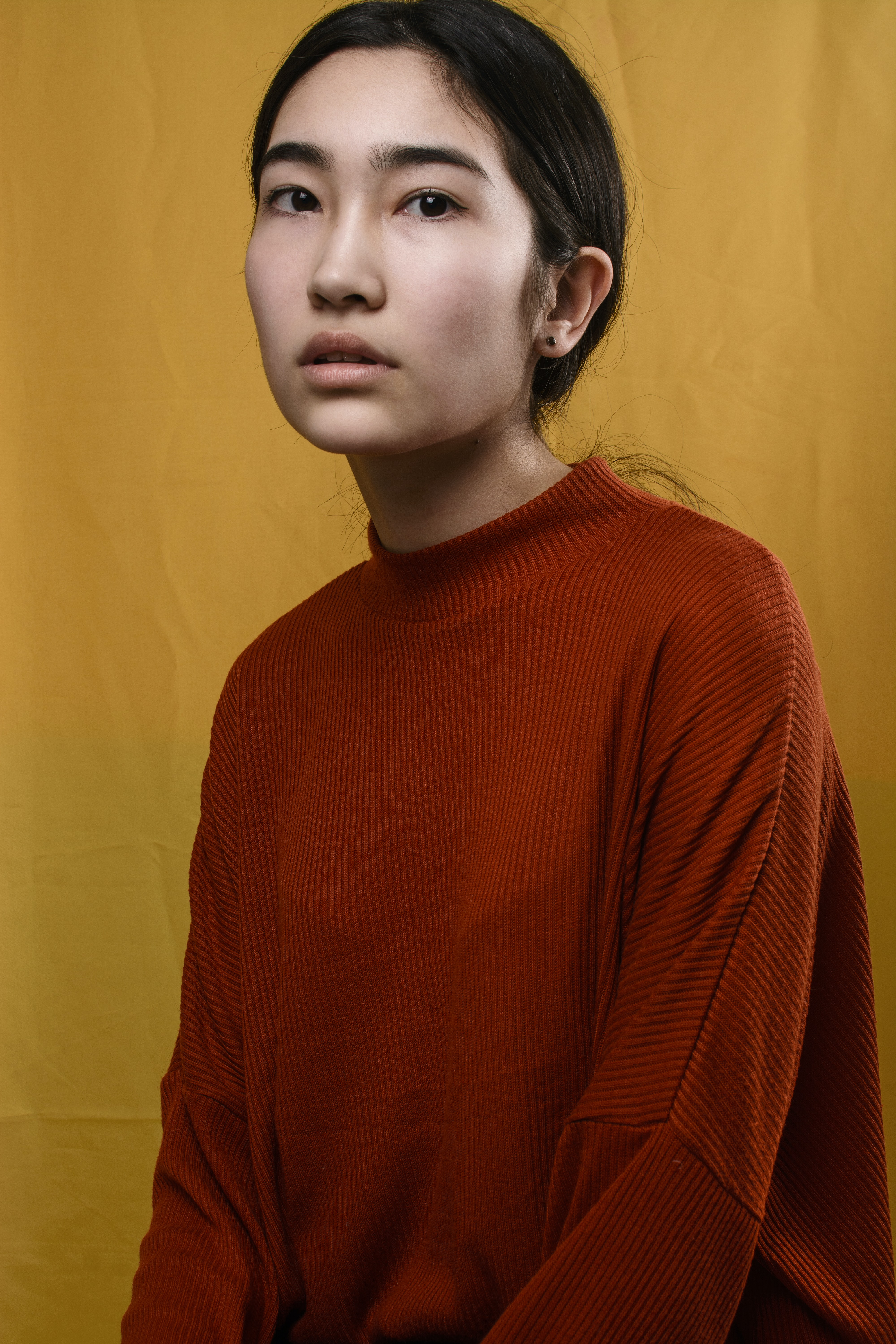 woman in red crew-neck sweater