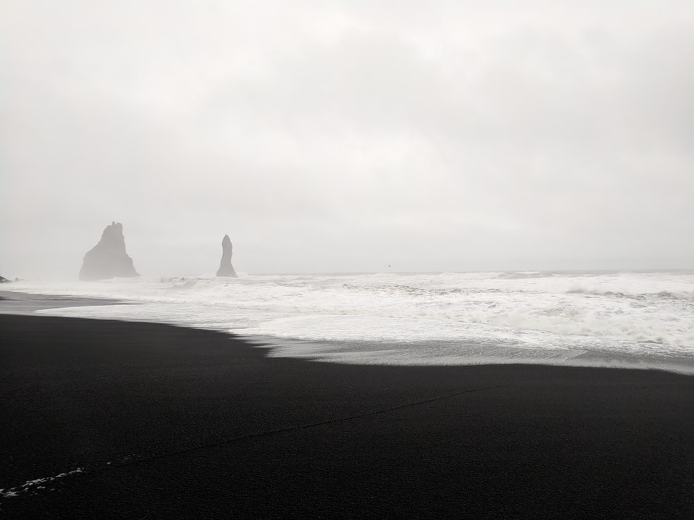 silhouette of sea stacks during daytime