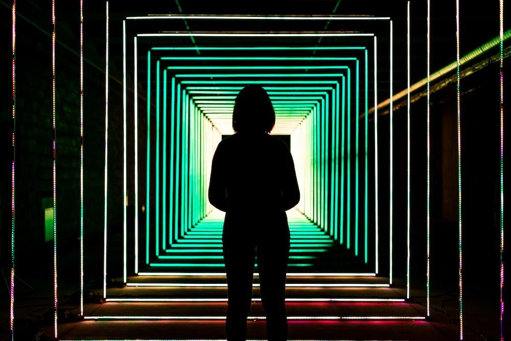 standing woman inside dark room