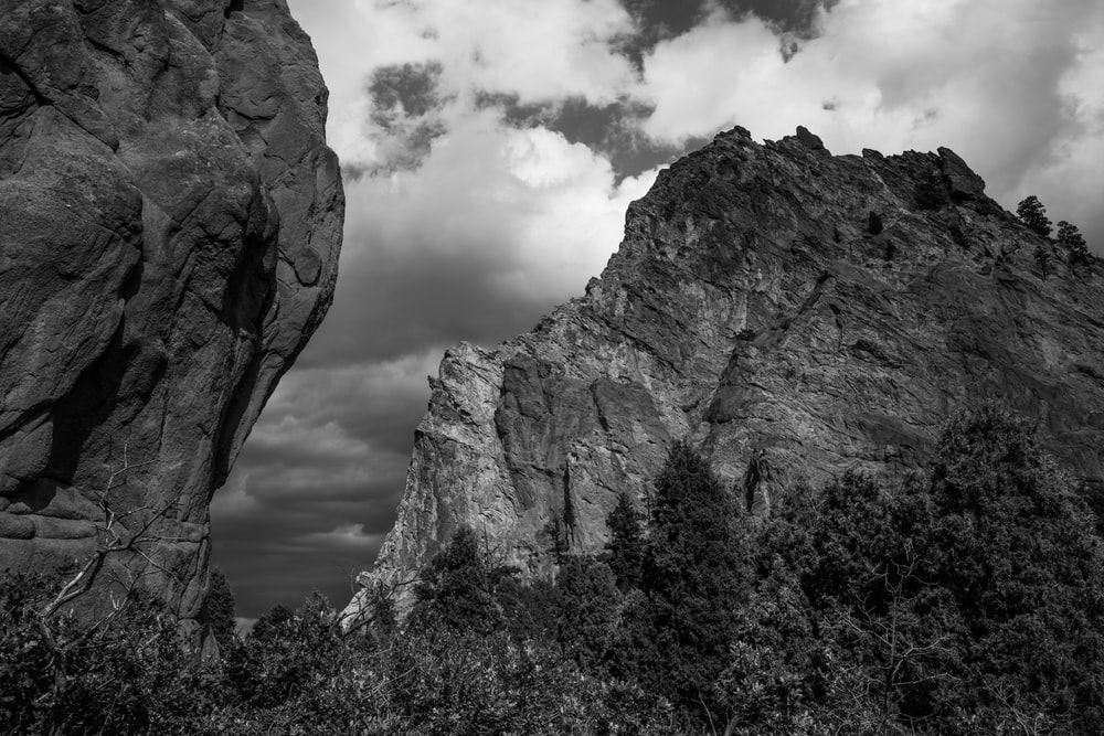 grayscale photography of rocky mountain