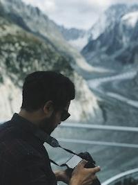 man checking his camera
