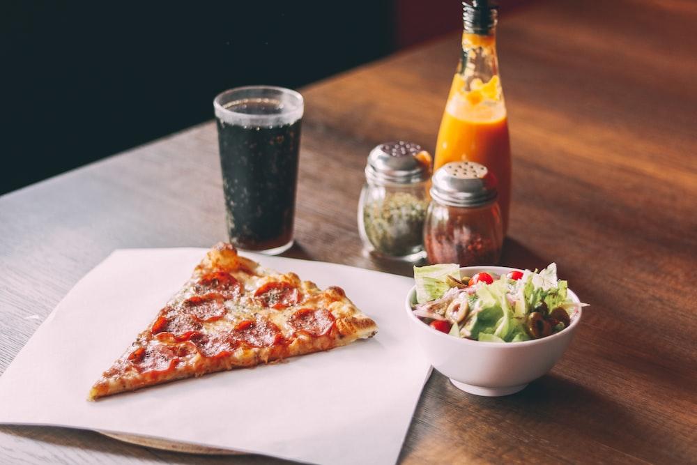 pizza beside soda