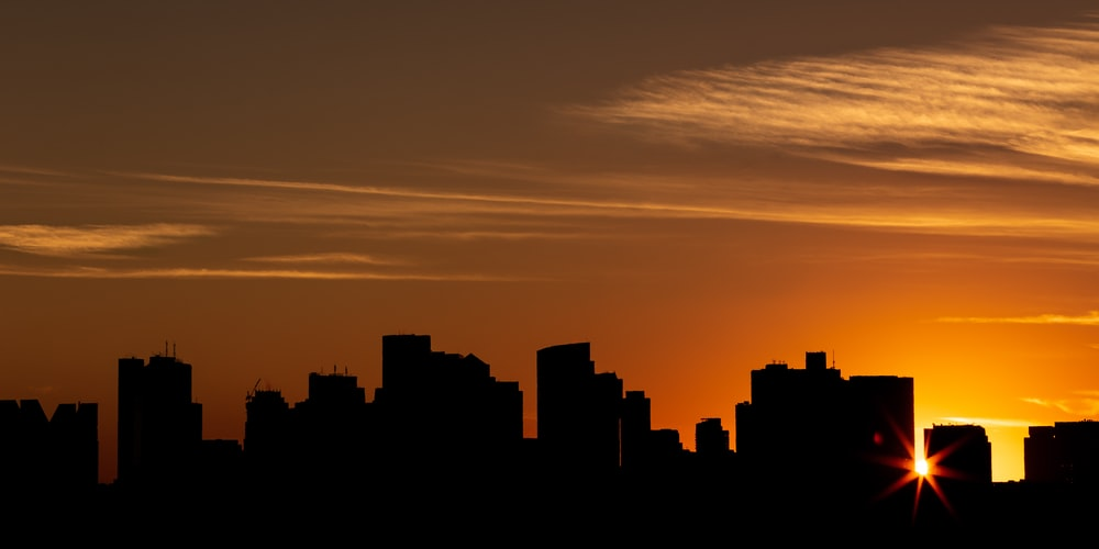 silhouette photo of buildings during sunset