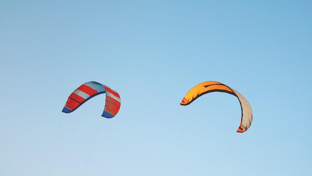 red and orange parachutes