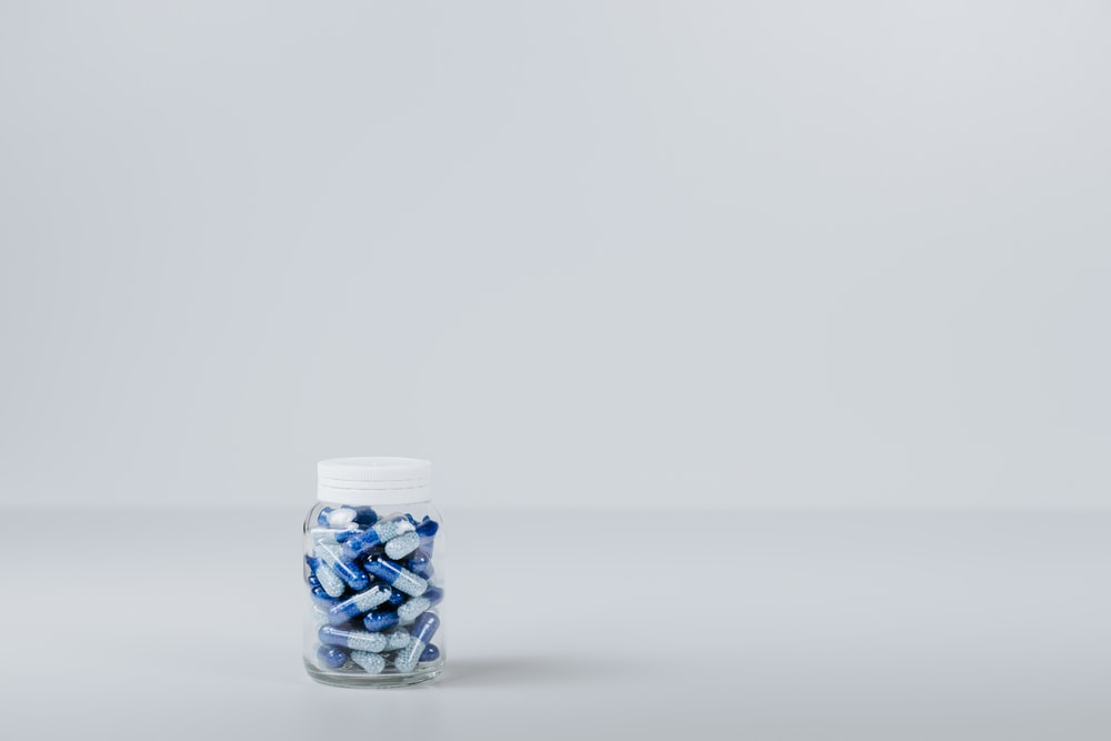 blue and white tablet in container