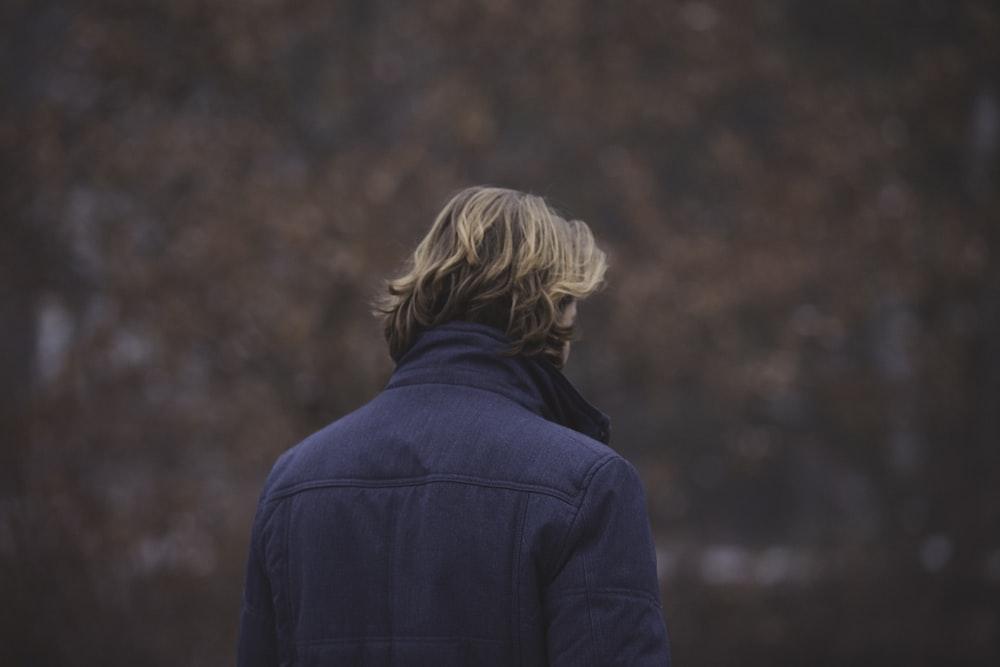 man wearing black jacket