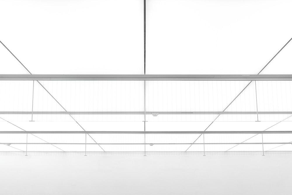 white wooden framed glass top table
