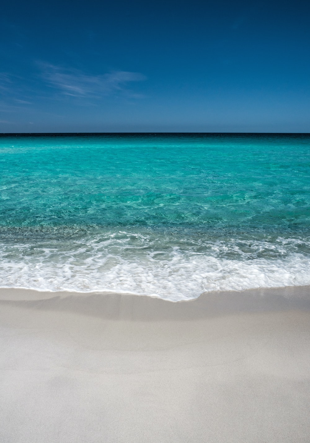calm green sea under blue sky