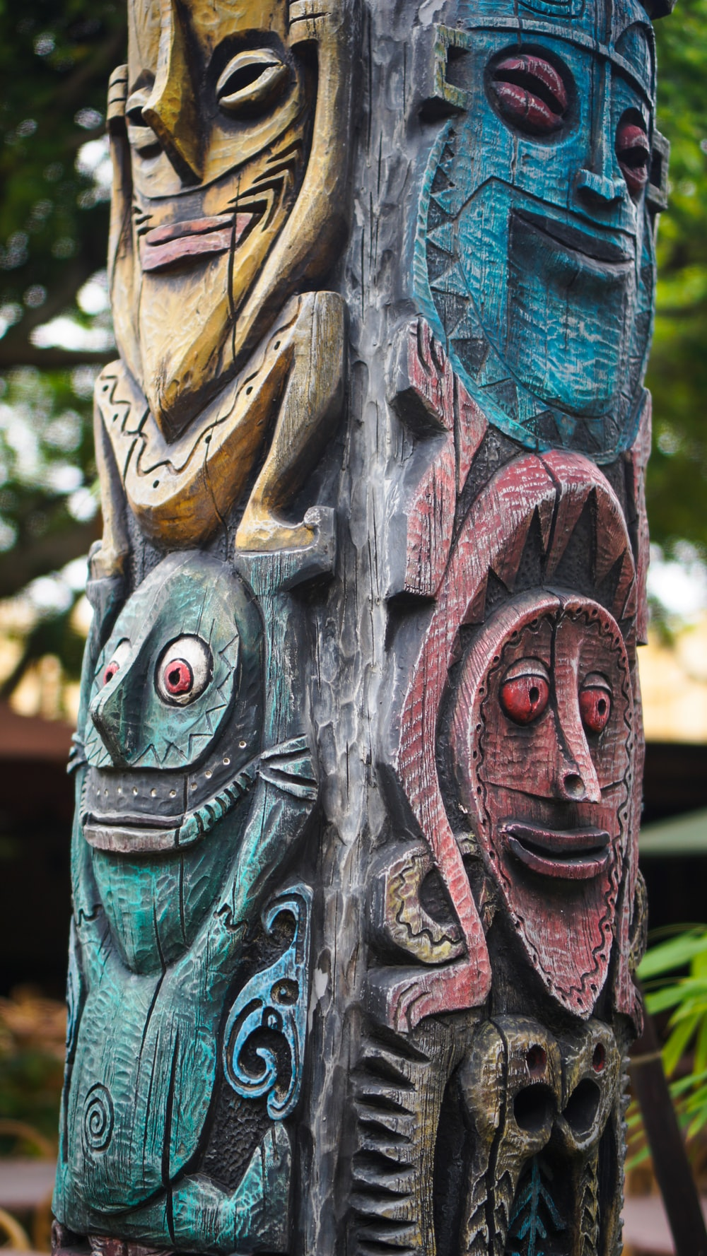 green, red ,and blue totem statue