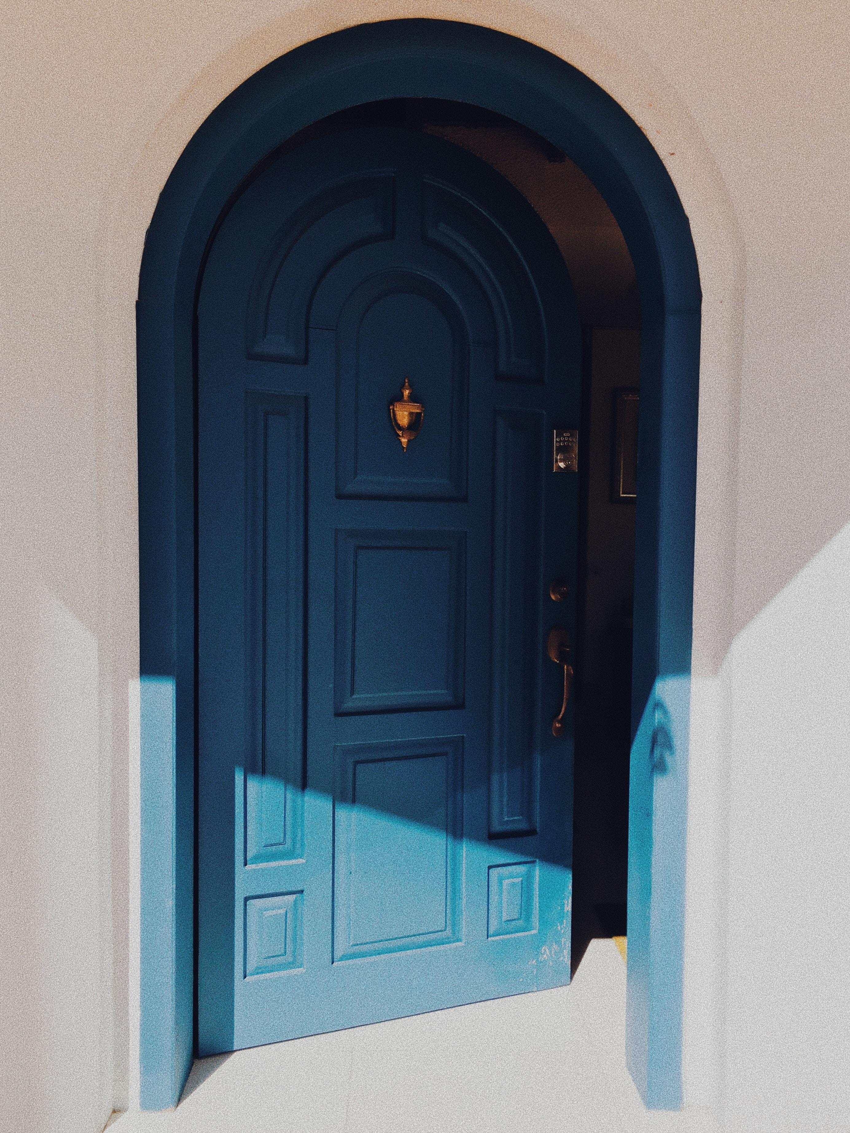 blue wooden 2-panel door