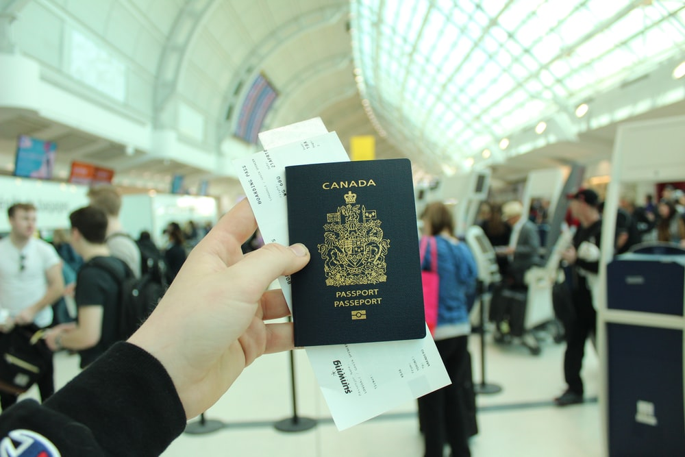 person holding Canada passport
