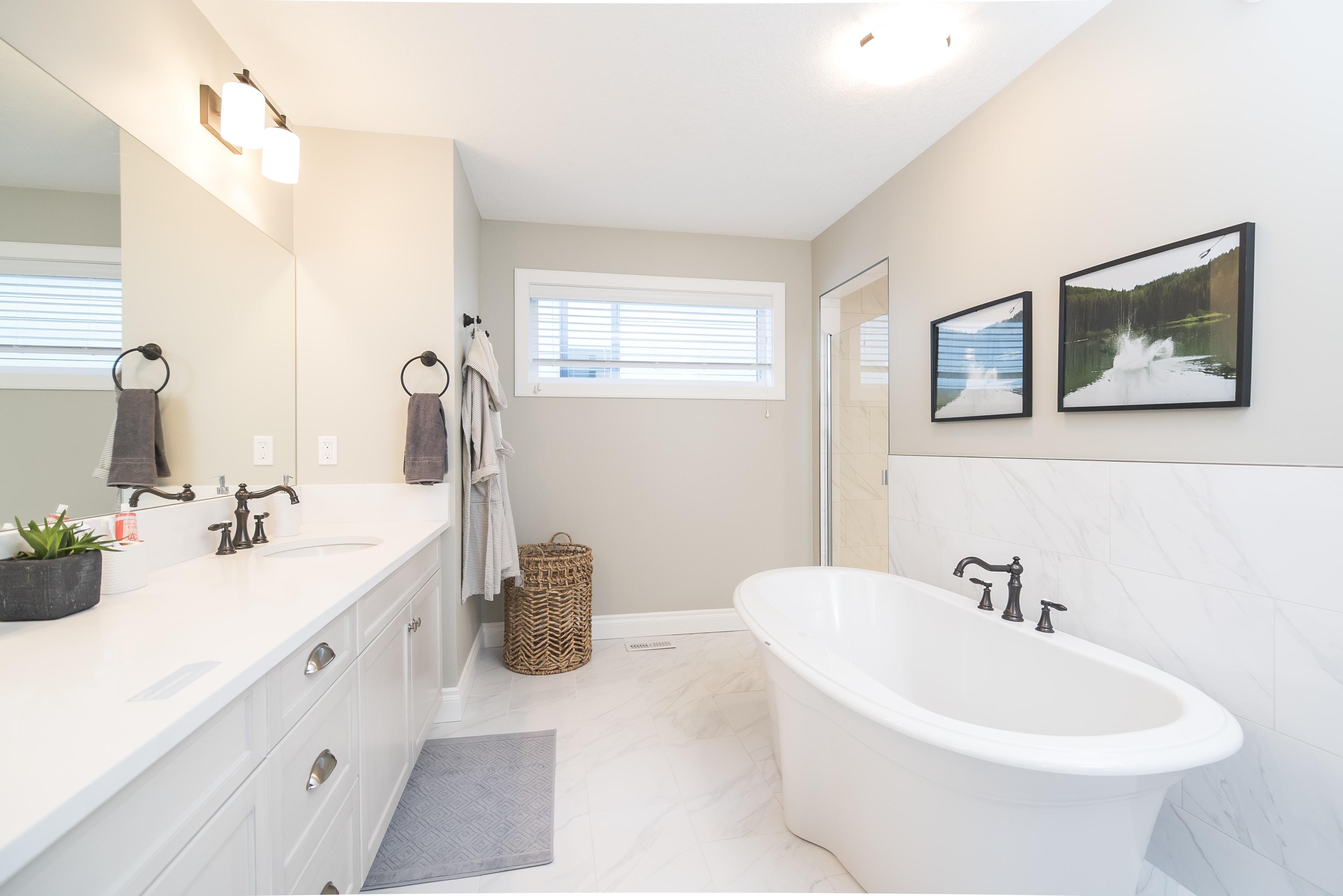 bathtub near sink inside room