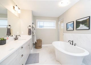 bathtub near sink inside room