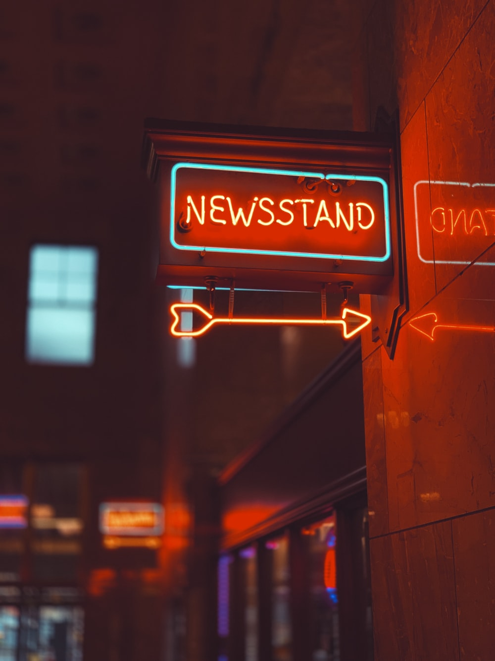blue and orange Newsstand neon signage
