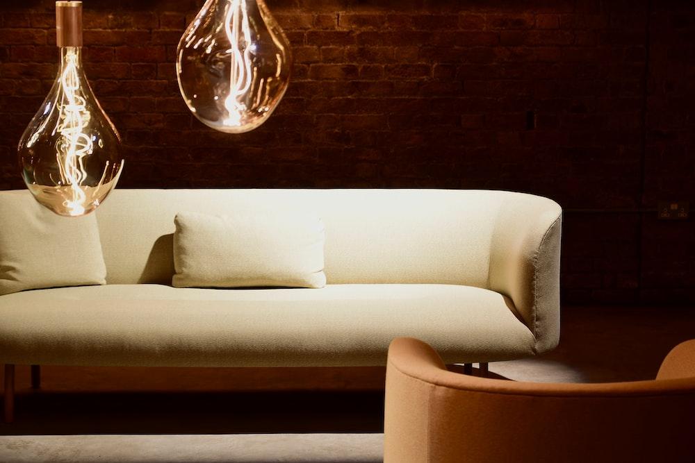 white leather sofa with throw pillows