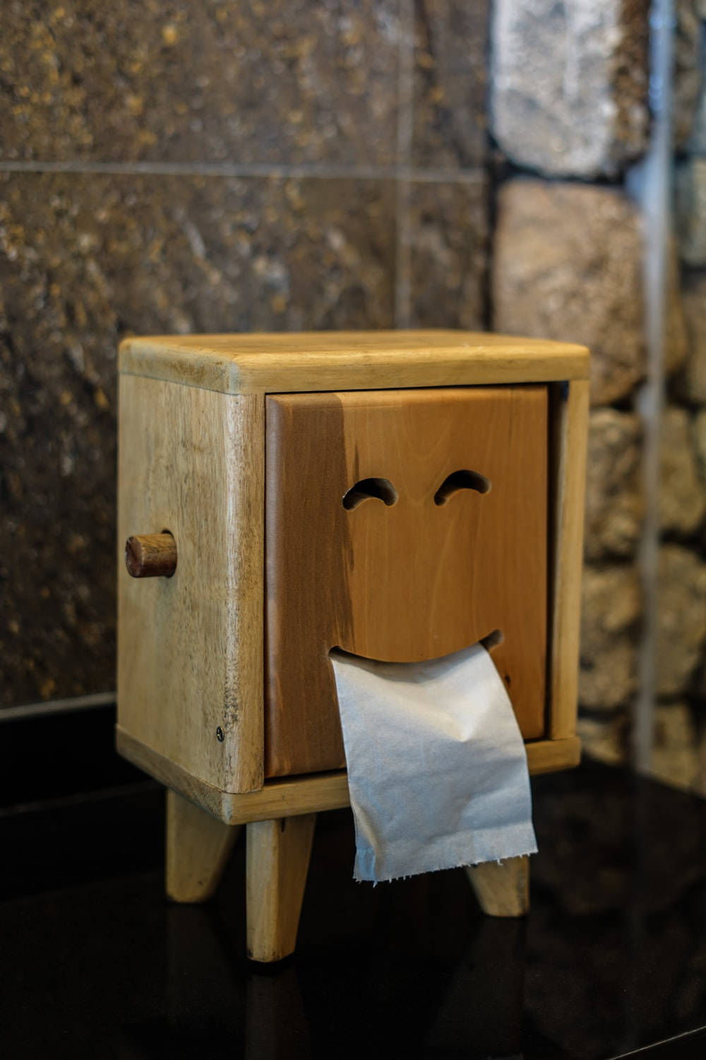 brown wooden tissue box