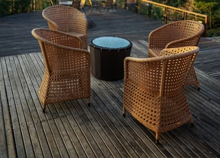 four brown wicker chairs