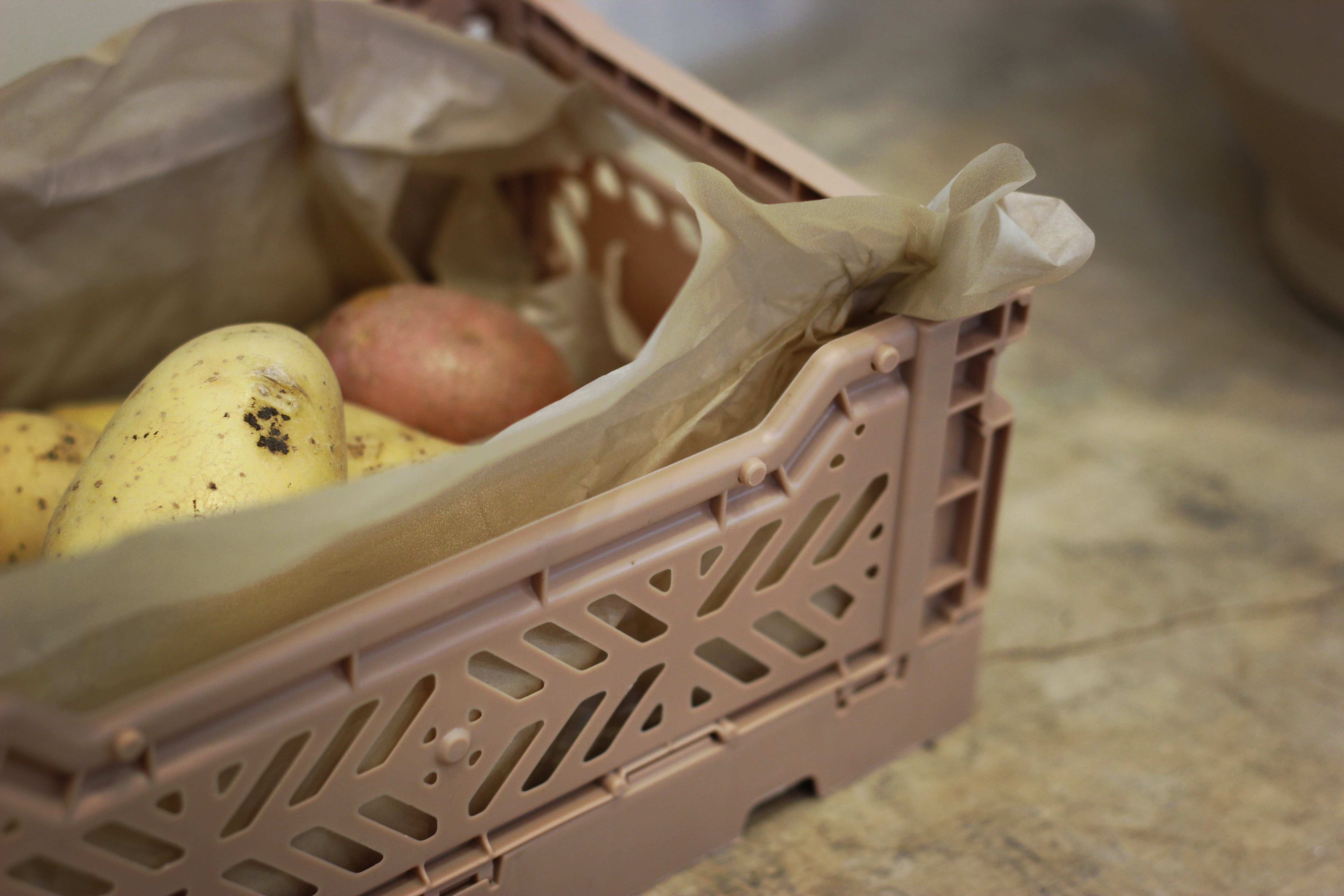brown plastic crate with fruits
