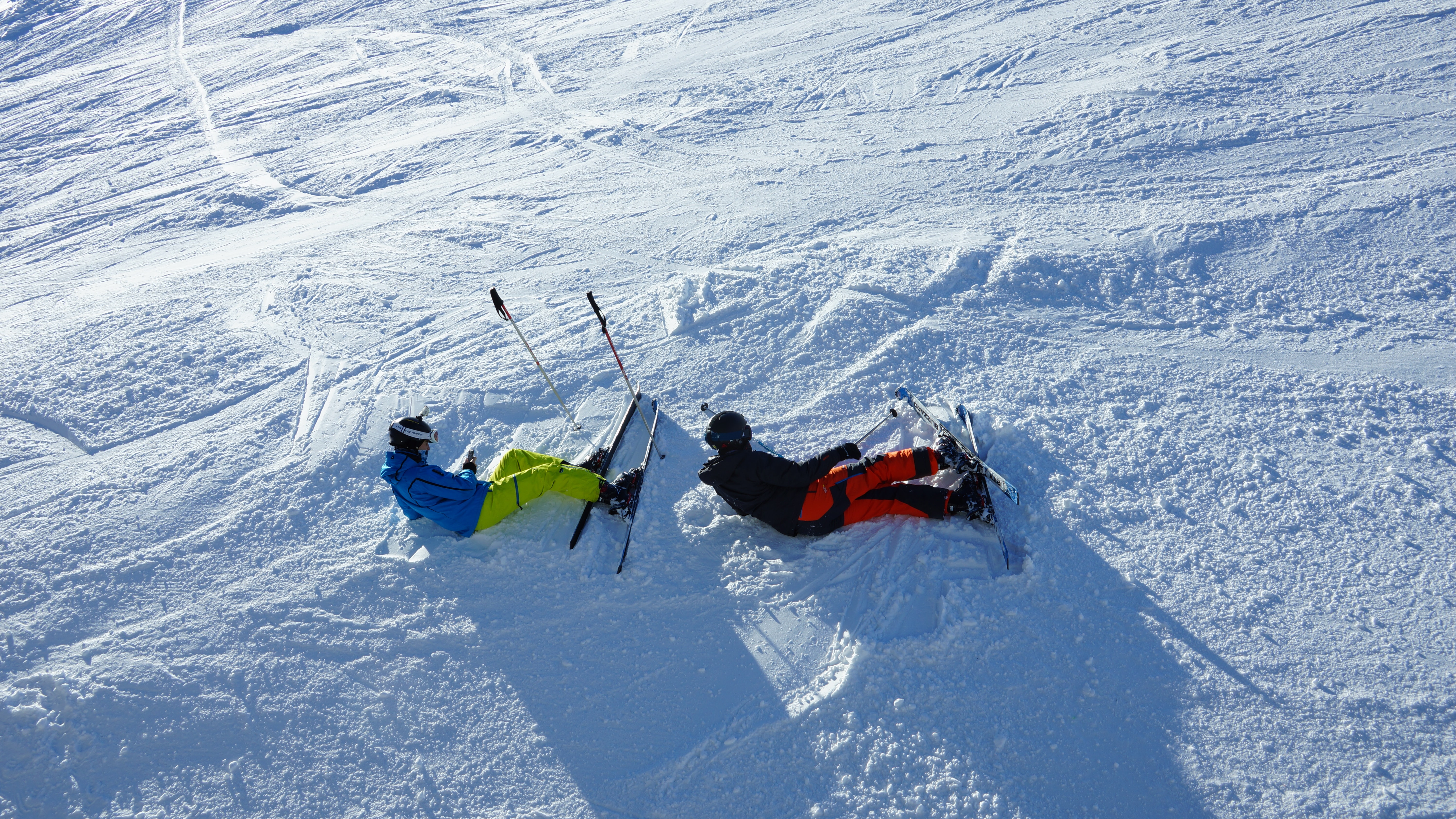 two men playing skis on field