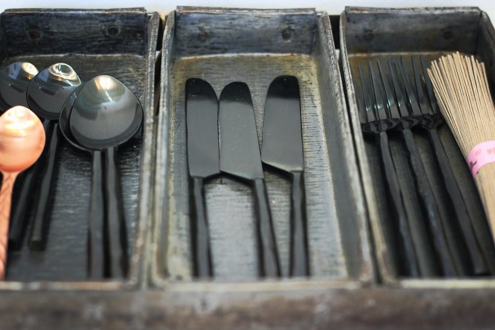 black wooden utensil trays