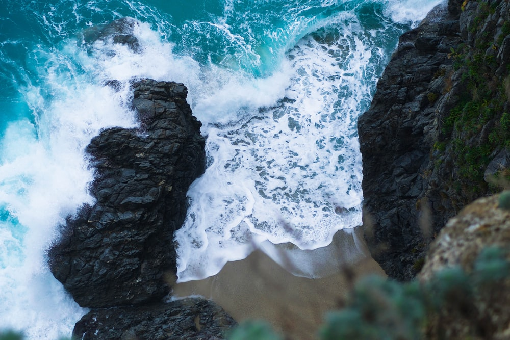aerial photography of rock formation near sea