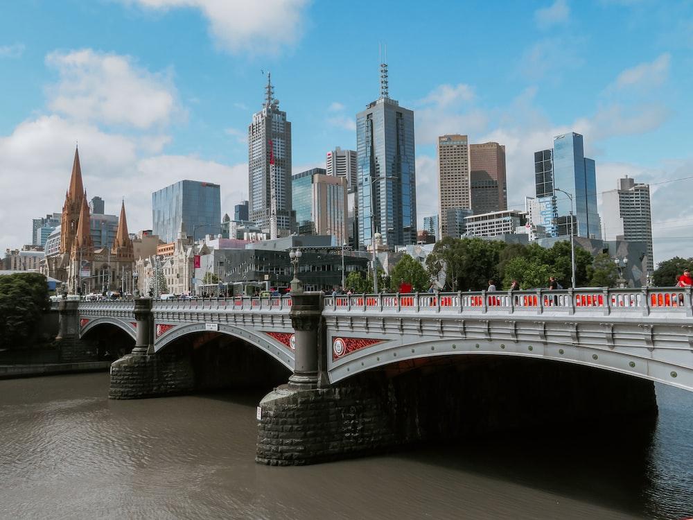 white bridge across city buildings