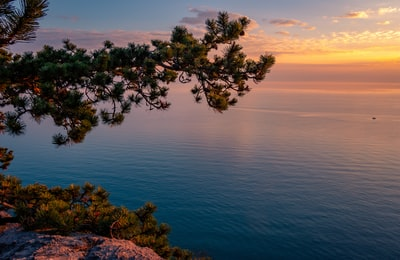 blue sea during sunset