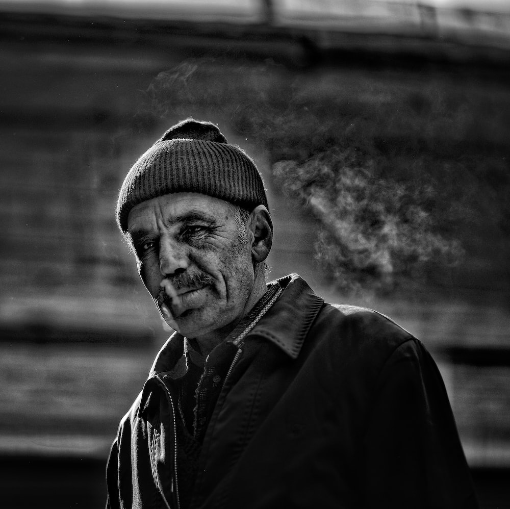 grayscale photography of smoking man