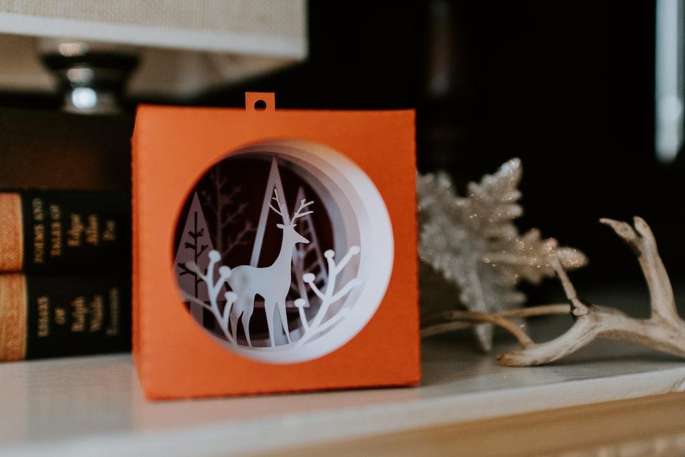 white and orange deer on box Christmas decor