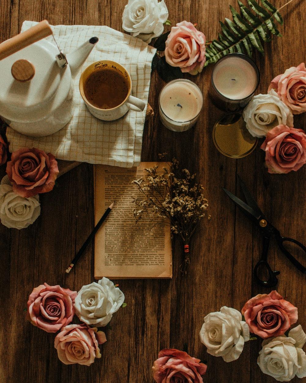 pink and white roses near white ceramic mug on table
