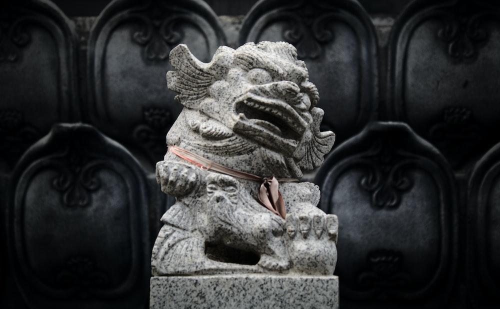 gray Foo dog statue across