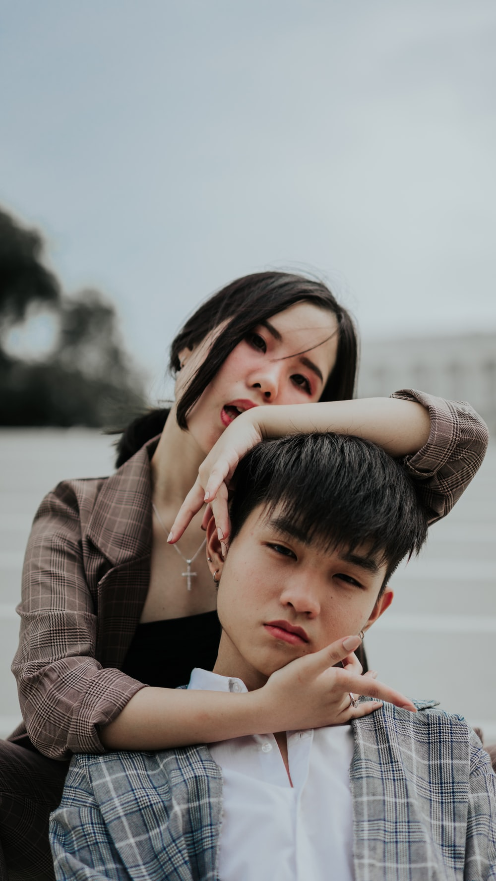 woman holding man's head