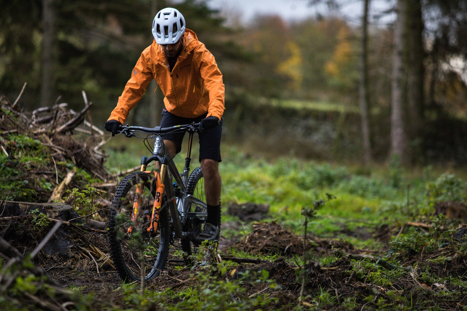 Man riding a mountain bike in the trees