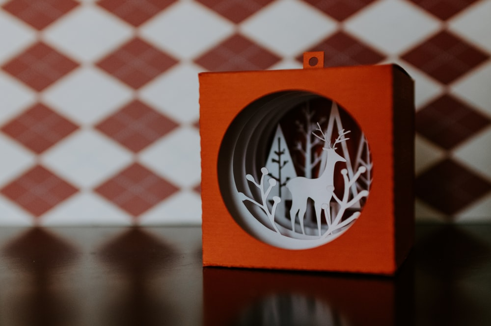 orange and white deer ornament